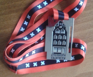 Medaille met Amsterdams grachtenpand
